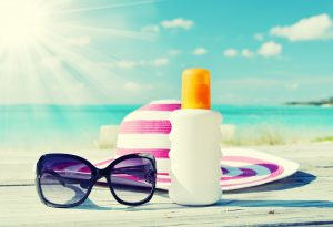sun glasses and sun screen beach